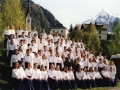 Choir in front of Alps